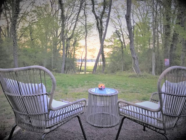 Come out the back door to relax on the patio and enjoy the river view. Deers are frequently right in the back yard.