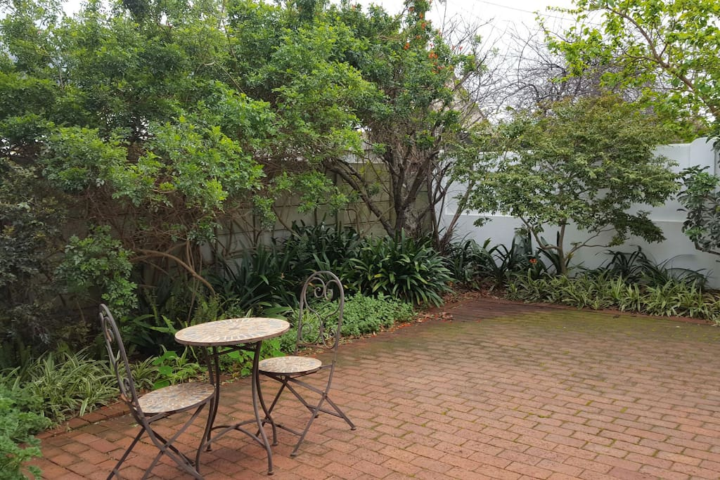 The garden courtyard is a great place to enjoy a chilled glass of local wine.