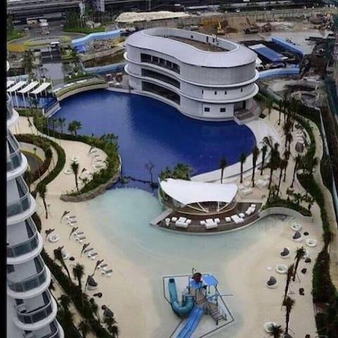 Paris Hilton Beach Club- visitor access pass included for 1 month stay.
