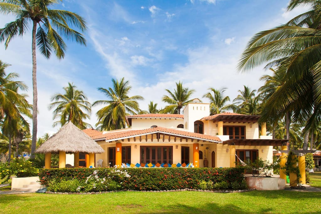 Tropical beachfront villa ready for your vacation