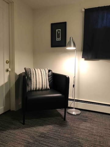 Your room features a comfortable chair and reading lamp.