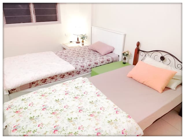 [2nd bedroom] Two single beds, 1 ceiling fan & shaded with a window blind.