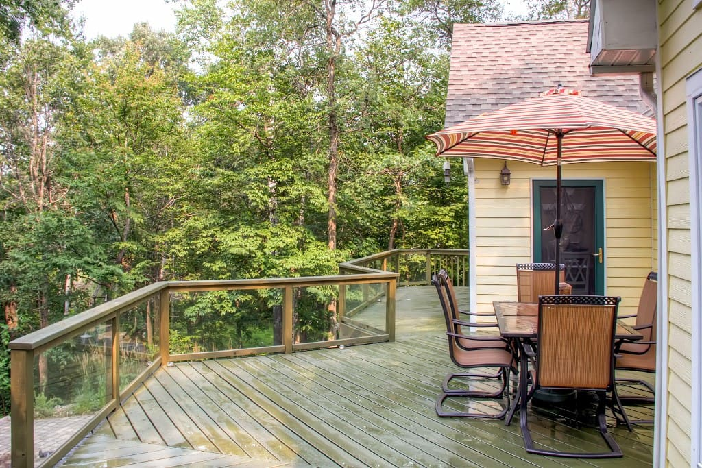 Spend countless hours enjoying the lush scenery and water views out on the private wraparound deck.