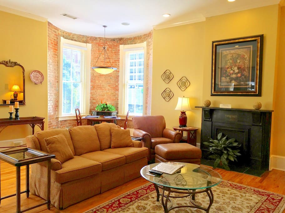 Living area and exposed brick breakfast nook.