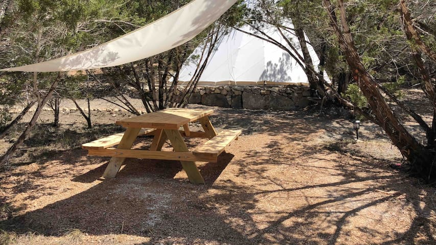 Picnic tables scattered throughout the property for guest use