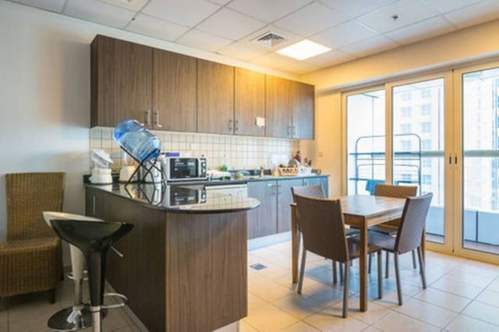 shared kitchen and dining area