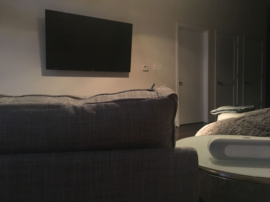 Relax on the chaise or giant lovesacs and watch Netflix, Hulu, HBOGo, etc. on this 60-inch Samsung Smart TV.