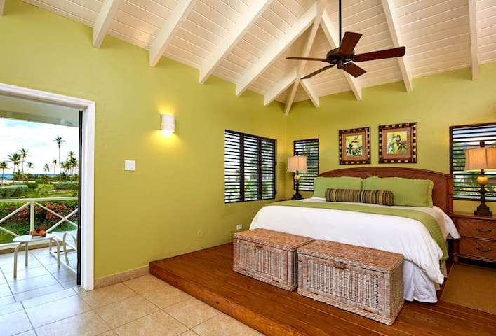 This suite features a king-size bed, living room area with pull-out sofa bed, full bath with shower, wet bar and balcony overlooking the ocean.