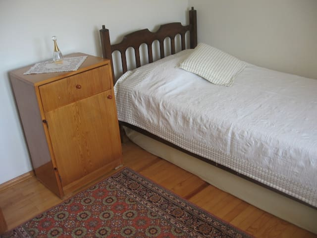 Second room on the first floor, with a single bed and a balcony.