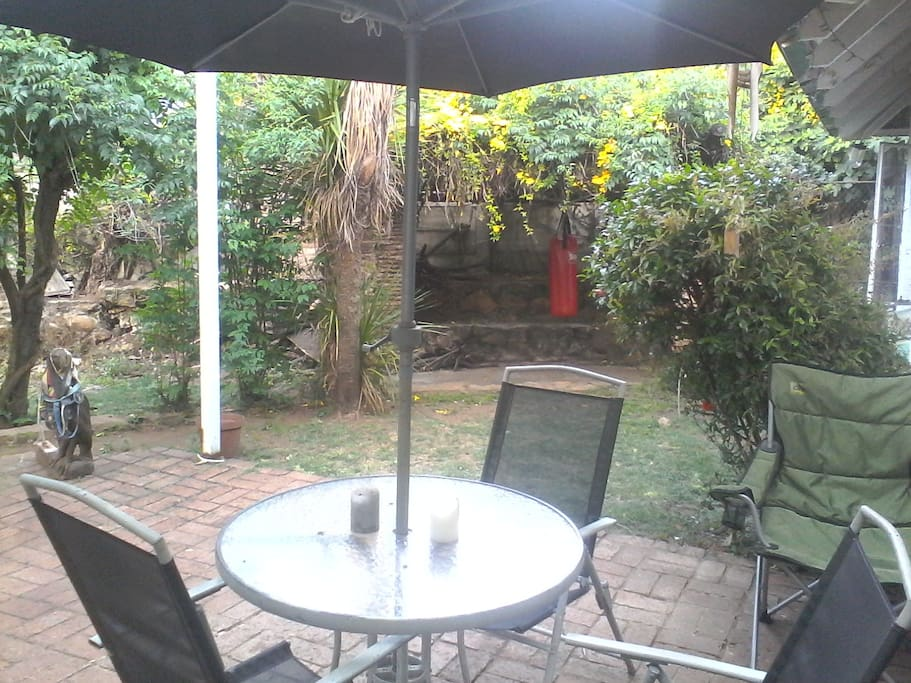Relaxing patio surrounded by gardens and birdlife
