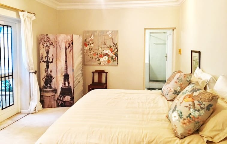 Large master bedroom with king size bed and en suite bathroom