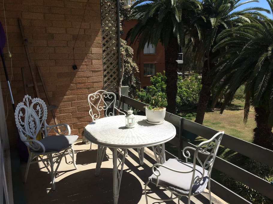 Balcony with comfy 3 piece setting & view of Narrabeen Lake.