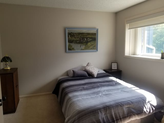Bright private bedroom with attached ensuite!