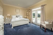 upstairs suite with king size bed with private balcony overlooking the rear of the property and our gorgeous willow tree