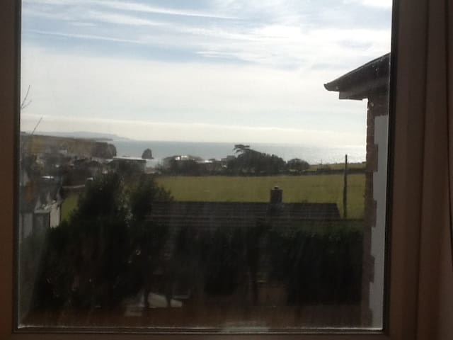 View from the double bedroom. Looks down over a field onto Freshwater Bay.