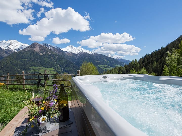 """Stunning Holiday Home """"Bergchalet Obertalerhof"""" with Mountain View, Balcony, Garden, Jacuzzi & WiFi; Parking Available, Pets Allowed"""