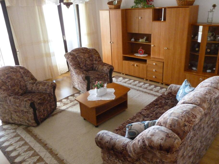 Living room is big, relaxing & it has 2 balcony doors which lead onto the large balcony. The balcony doors let the light in & the cool summer breeze.