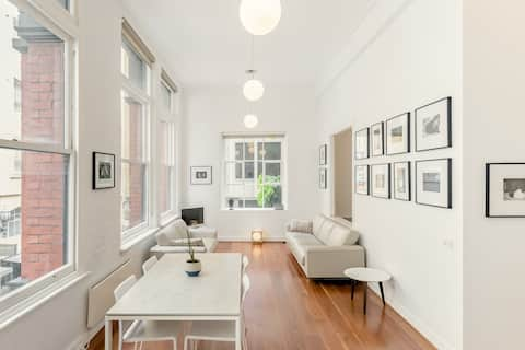 Visit Fashion Houses from an Airy, Minimalist Flat