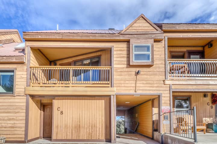 Condo with mountain views, cozy wood burning fireplace, & private gas grill!