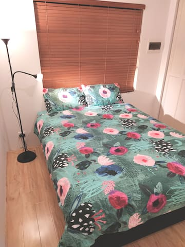 2nd Aircon bedroom with queen sized bed,wardrobe,side table, standing lamp,leads to adjacent second common bathroom/toilet/laundry area