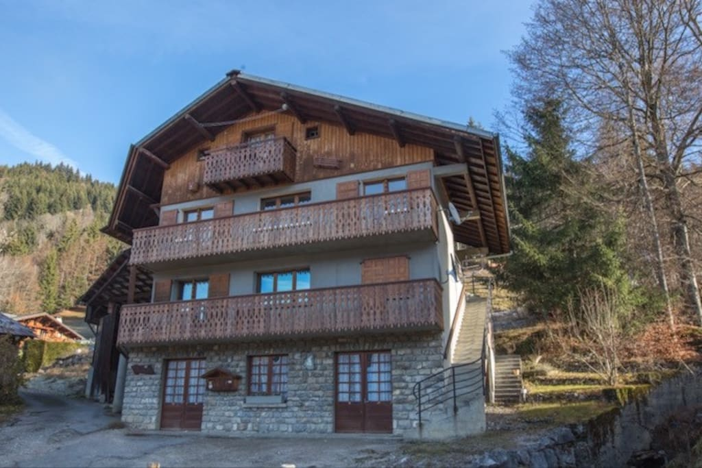 The flat is accessed through the stairs on the right of the chalet