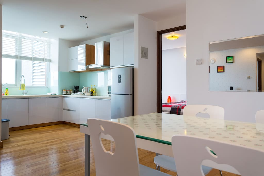 Full kitchen with city view, coffee maker, micro wave oven, free mini bar.