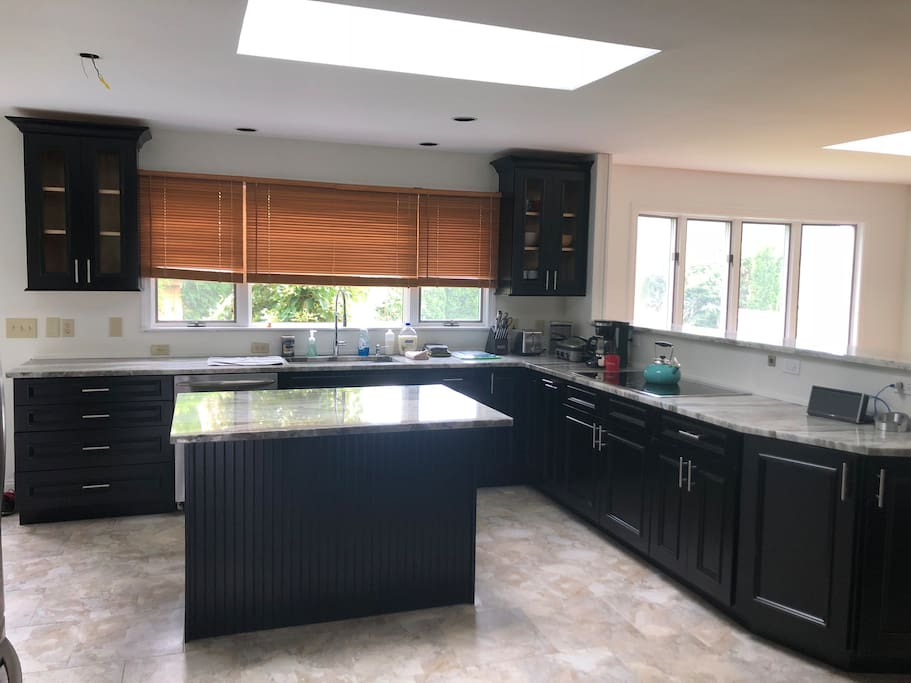 Kitchen with stainless steel appliances and granite
