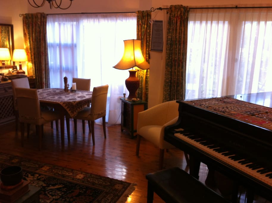 Grand piano in the cosy living dining area
