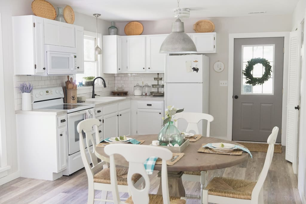 Nicely equipped, light & bright farmhouse styled kitchen for cooking homemade meals