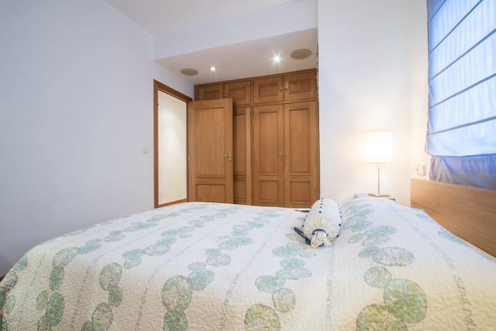 The spacious master bedroom with fitted wardrobes.