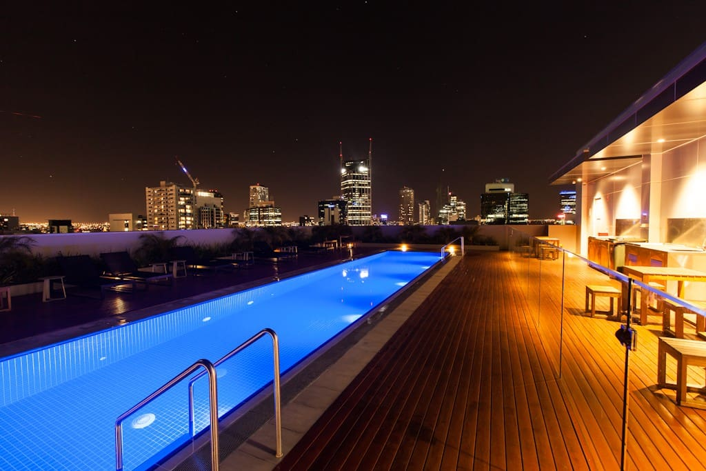 Night view of the Rooftop Pool  Swimming pool, patio and BBQ facility