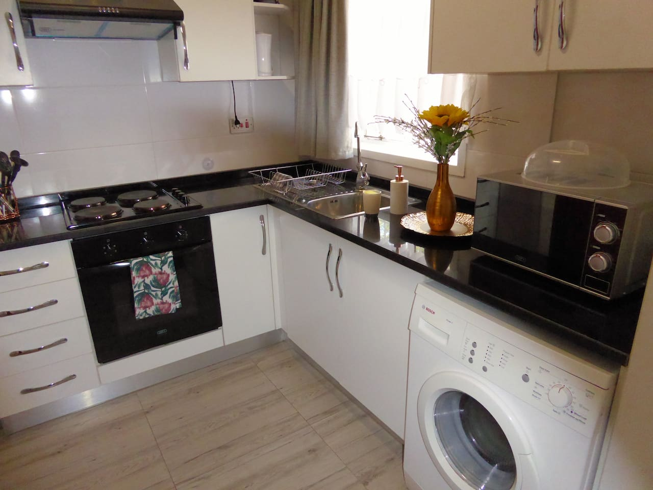 Fitted kitchen - stove, fridge, washing machine, microwave & cooking utensils
