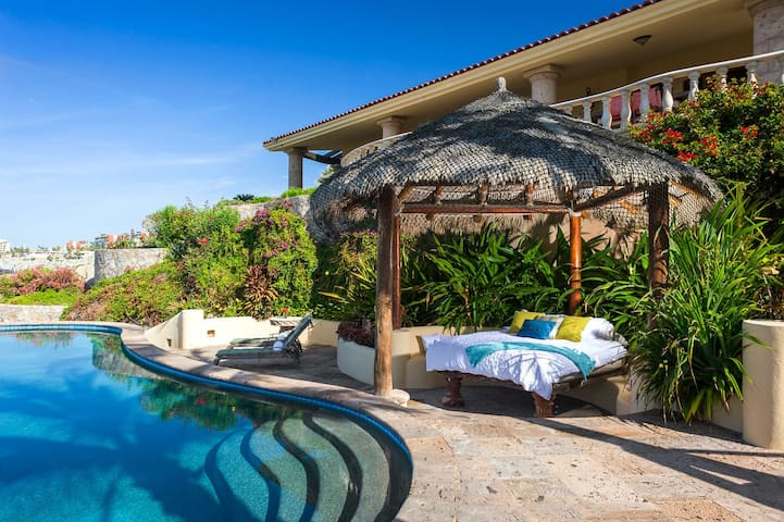Take your relaxation to the next level by taking a quick poolside siesta under the palapa!