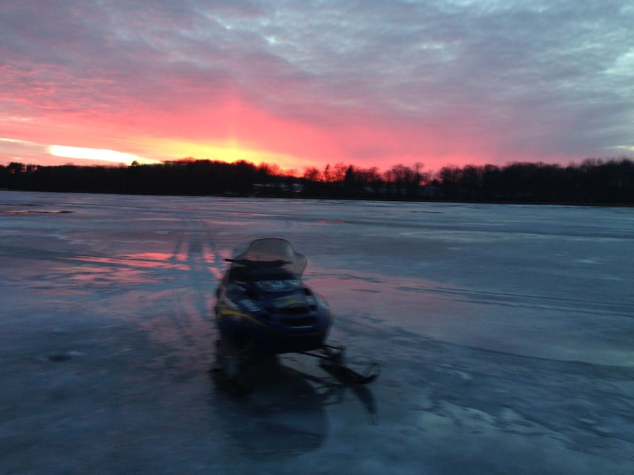 Lake ice,  snowmobiling, and breath taking sunsets in 'God's Country'