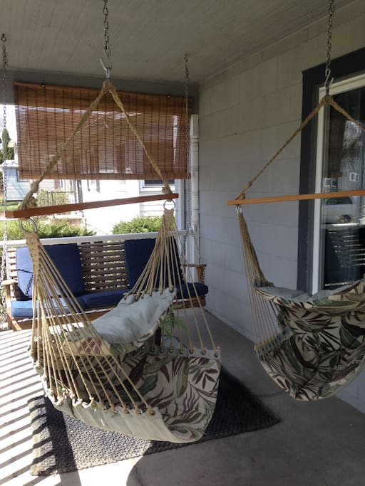 Comfy swings on the front porch.