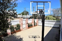 secure parking area with basketball ring, remote control gate for entry