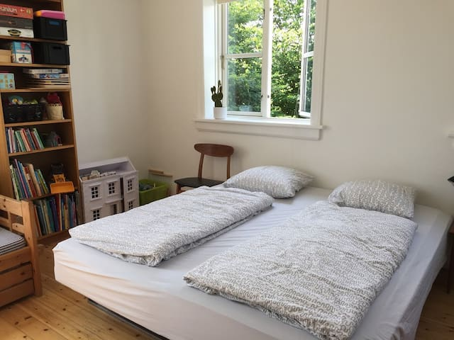 Room 5: Beds: 1 double bed and up to 3 singles