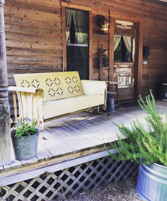 Front porch and antique metal glider.