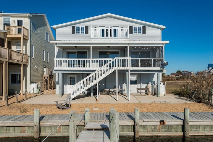 Serenity Now is a stunning waterfront Vacation Rental on the Eastern Shore of VA in Captain`s Cove Golf & Yacht Club only minutes away from Chincoteague Island and Assateague Island National Seashore. Enjoy the Bay, the Beach, and the wild ponies.