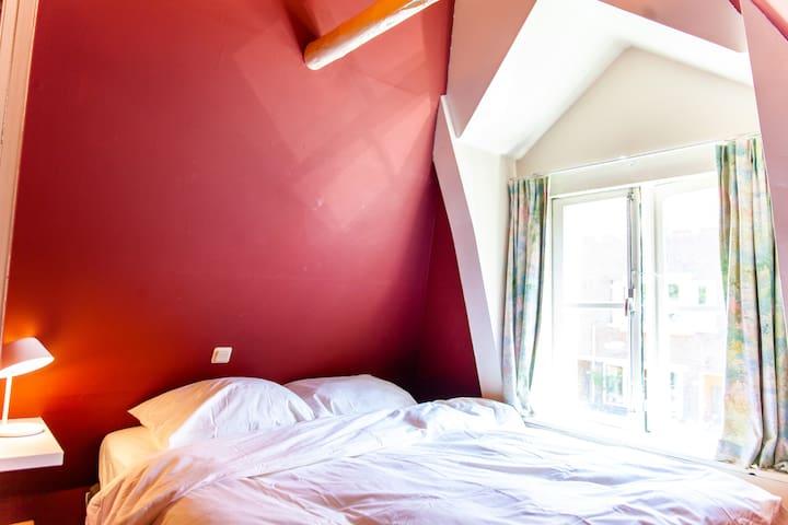 Cozy bedroom with historic windows