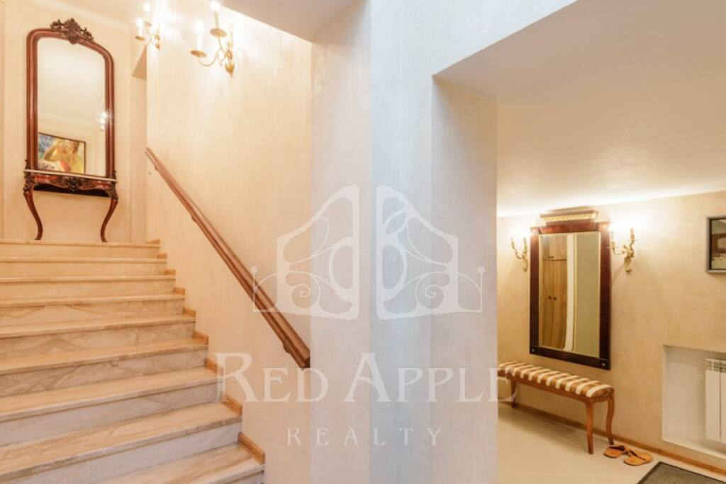 We have a private enter to the building right from the backyard. First level: hallway and loundry. Royal marble stairs to the second level