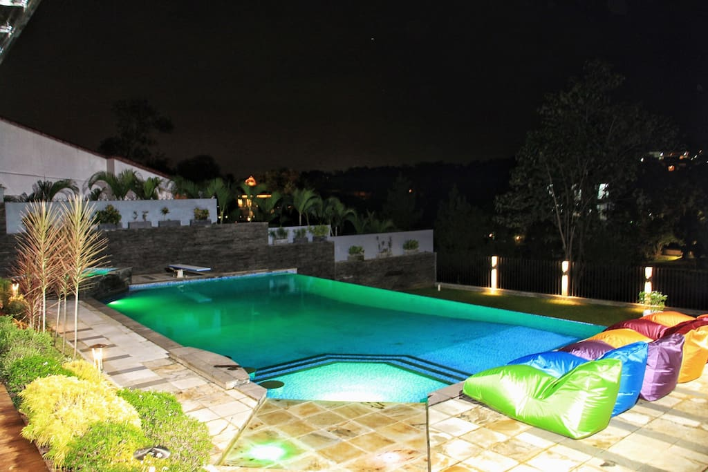Pool area at night with LED color-changing pool lights
