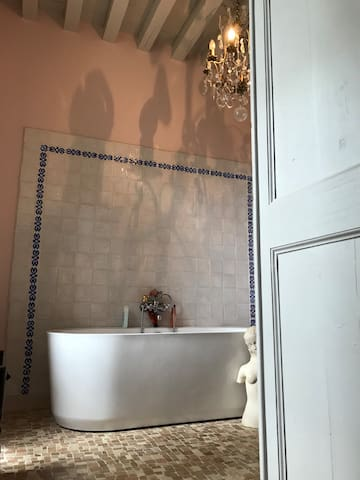 1 of the 2 private bathrooms for guests. The other has a stand up shower with Italian stone