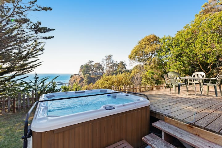 Charming oceanfront home w/ a wood stove, private hot tub, & water views!