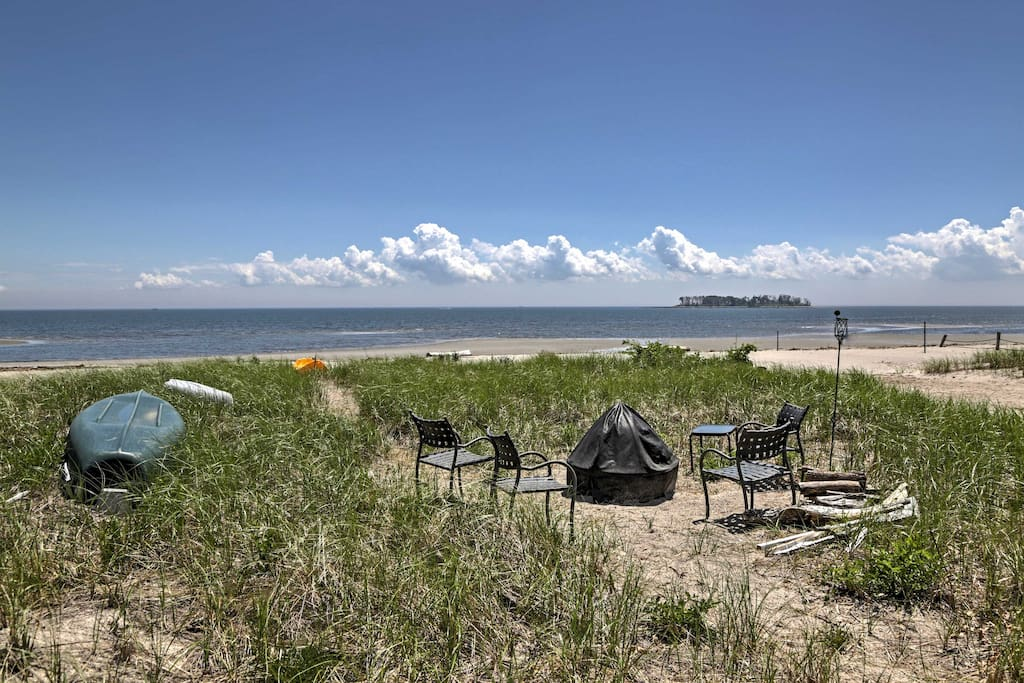 This private beach is all yours, plus a fire pit and canoe!