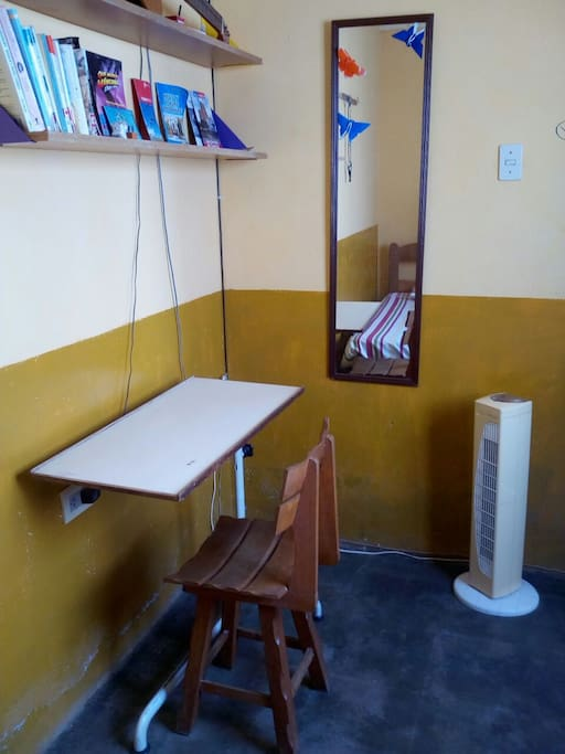 Little desk, chair , mirror and a fan perfect for Mancora weather