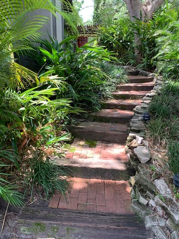 Once you check-in, we'll guide you down this path which leads to the Airbnb space. Please note this is a path of bricks and railroad ties and we are not handicapped accessible.