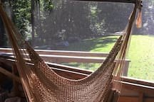 Cant you just imagine swaying in this hammock? Richmond is located in the mid-Atlantic, so there can be lots of mosquitoes in the summer. That's why we love having the hammock swings on the screen porch of the treehouse.