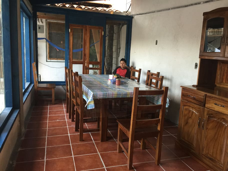 Large dining room for family meals, family not included.