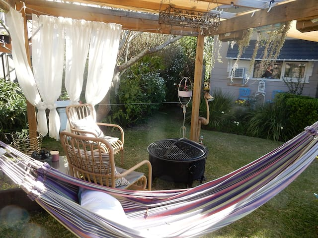 Your garden with Fire Pit/ BBQ and 2 Hammocks.